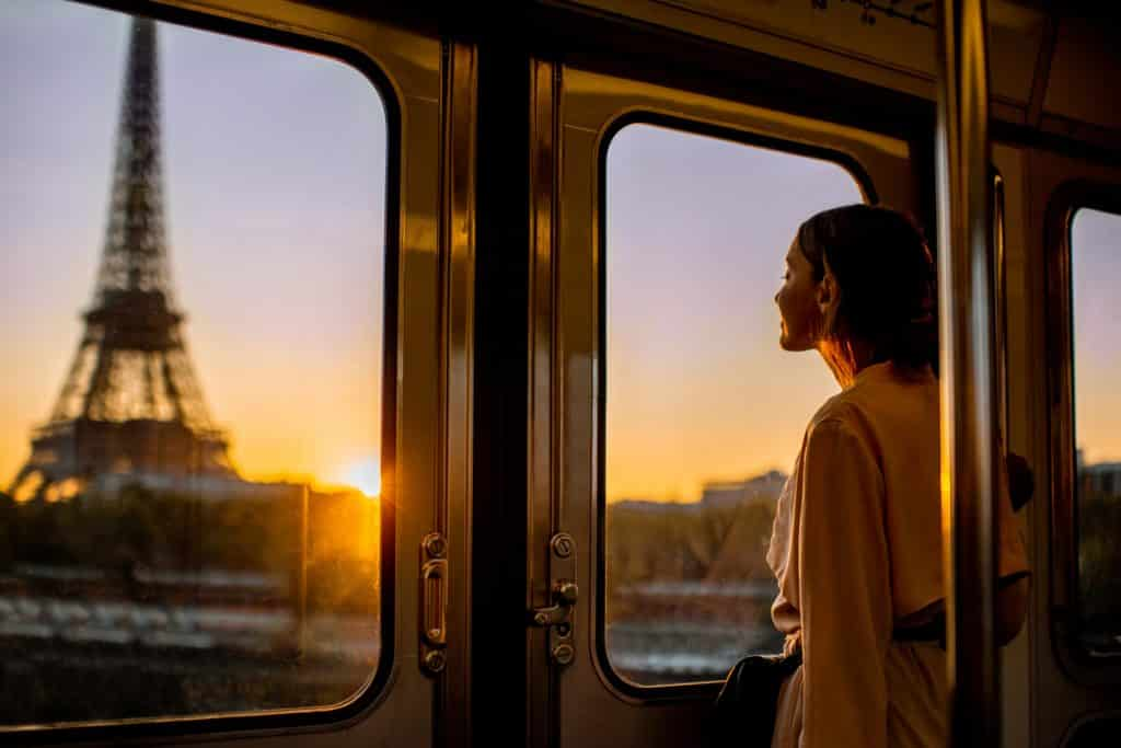 Woman enjoying morning view on the Eiffel tower