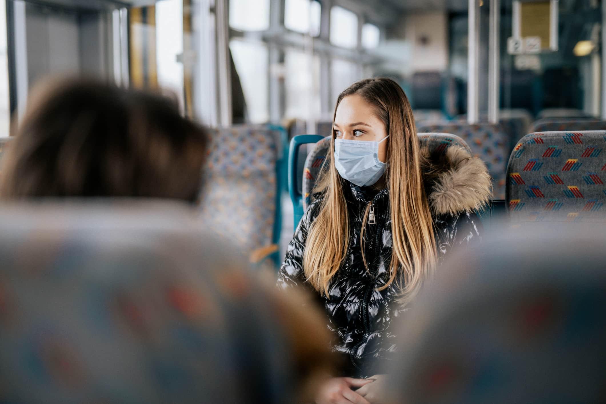 Woman wearing a mask on a train