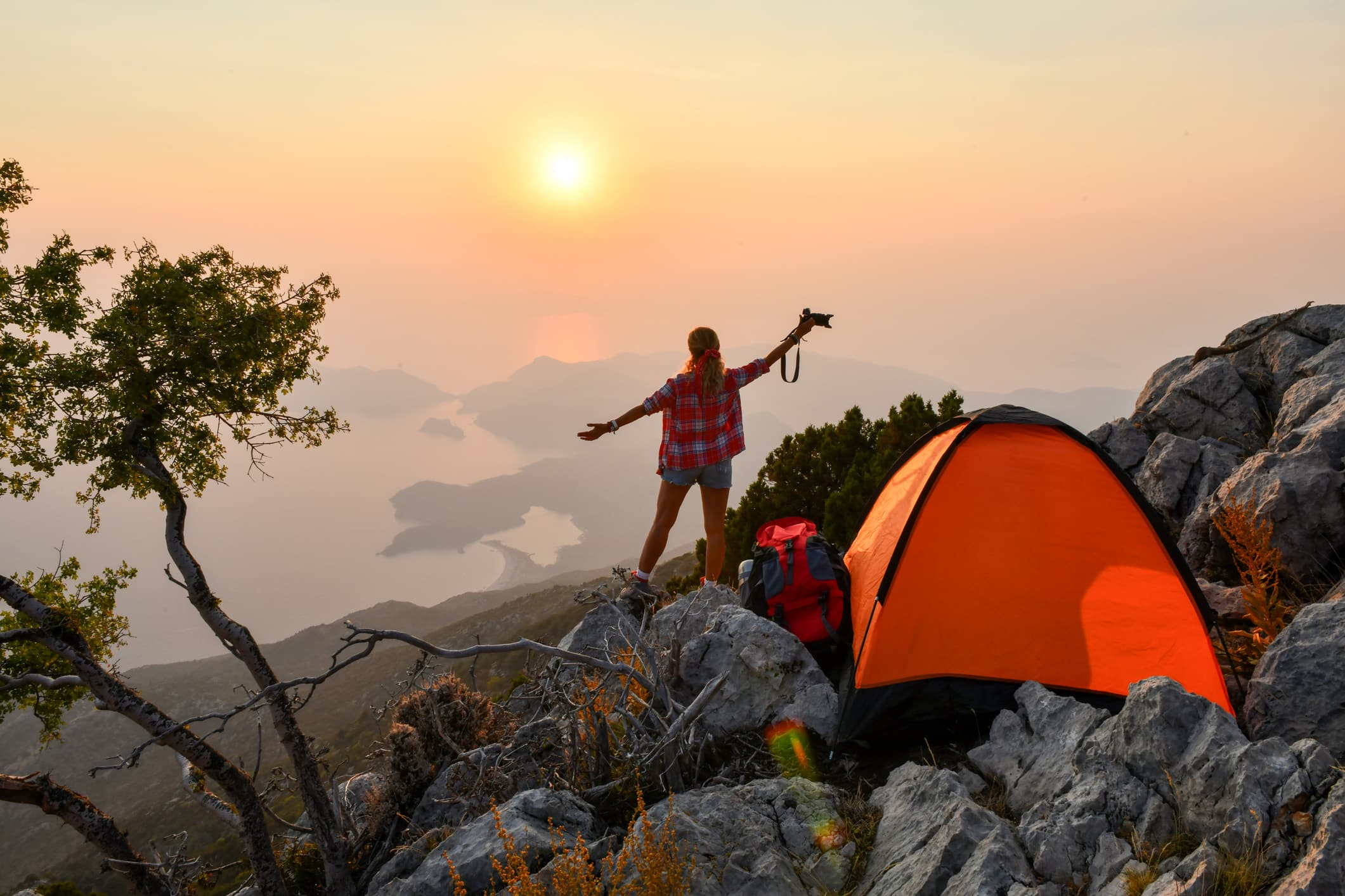 Woman camping solo on a mountain