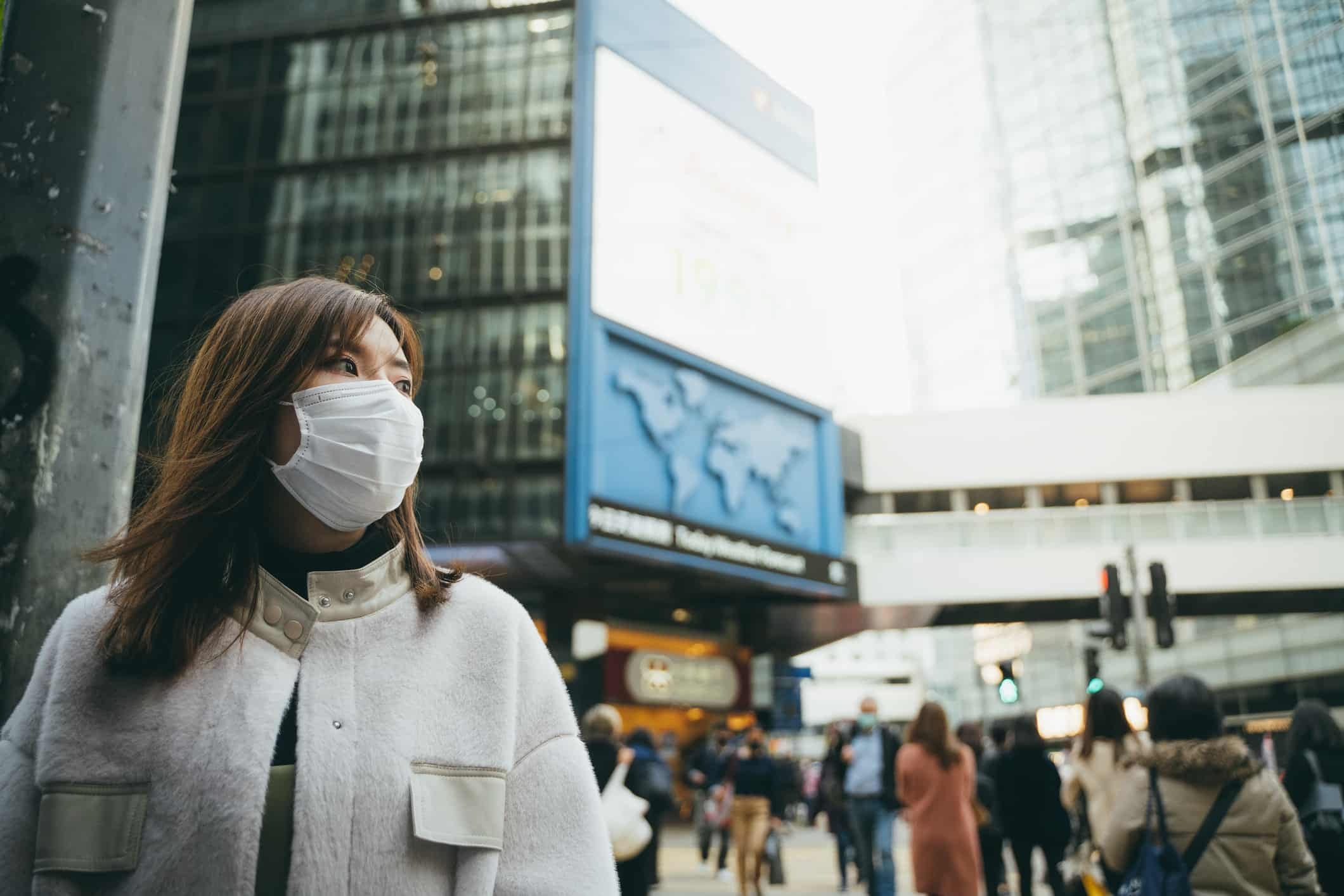 Woman wearing protective mask on the street