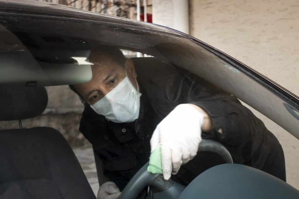 A driver who disinfects his vehicle during the pandemic