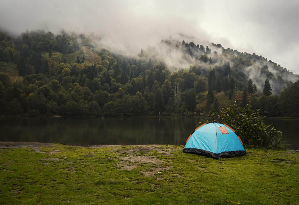 A camp tent by the lake