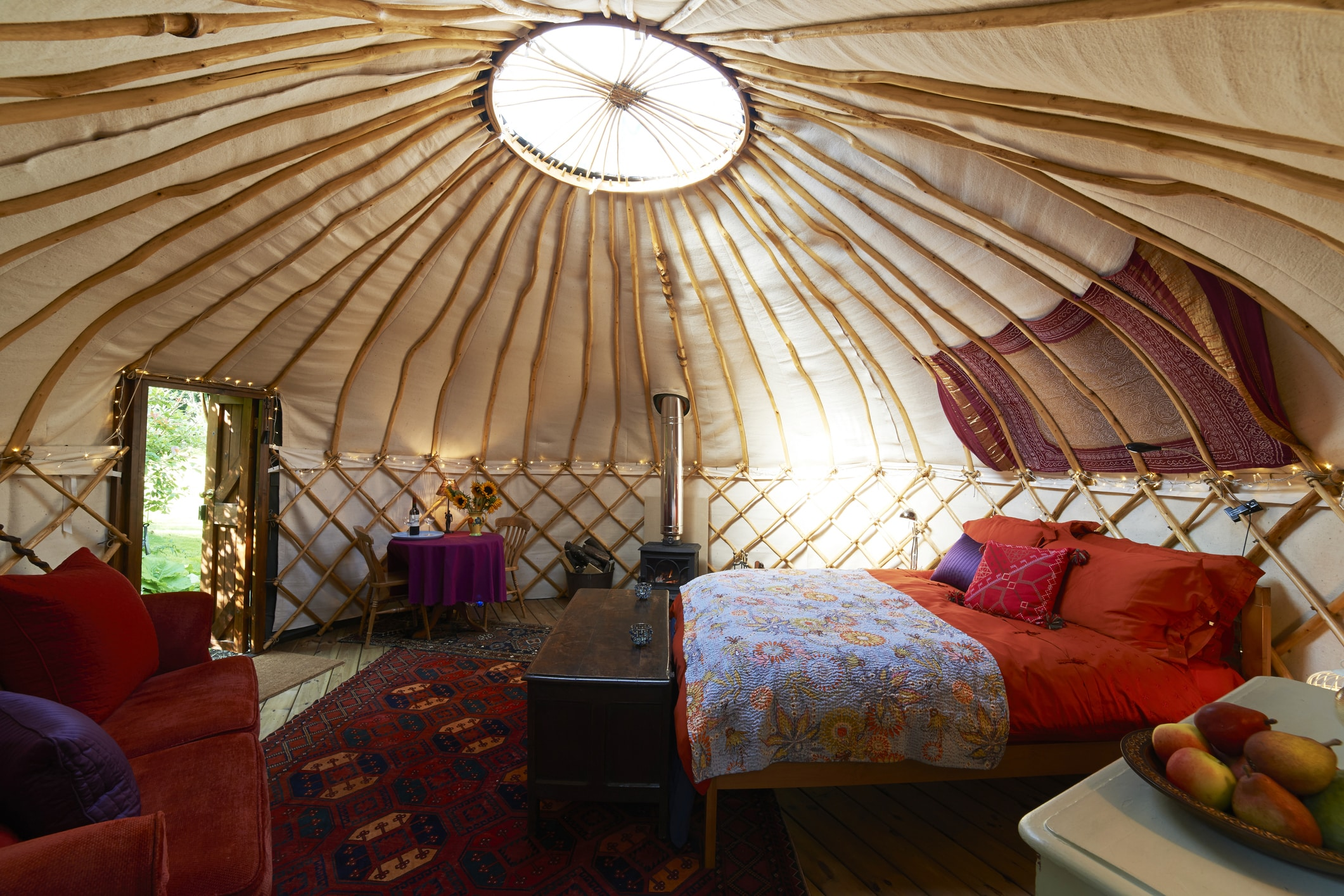 A view of the bedroom in a glamping tent